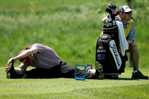 Men Stretches Before Playing Golf