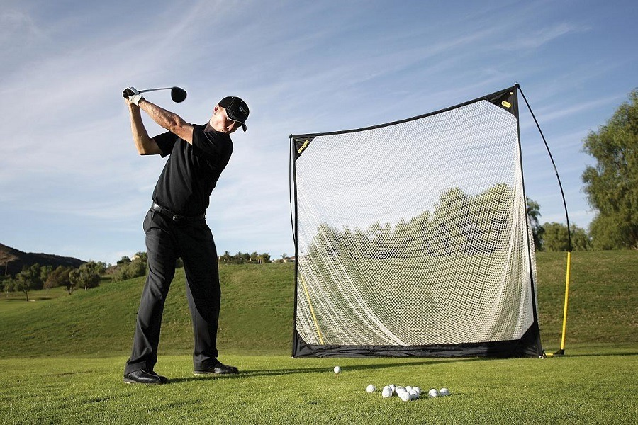 Man Playing Golf with Golf Net