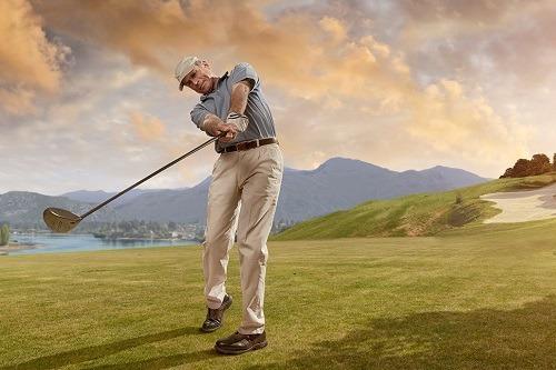 Man Swinged Golf Ball in Sunset