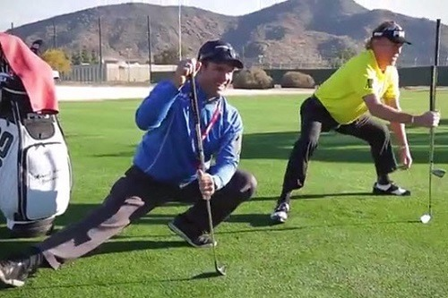 Two Men Stretching Before Playing Golf